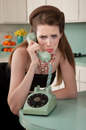 Photo for Mascara smeared housewife crys on phone in a retro-style scene - Royalty Free Image