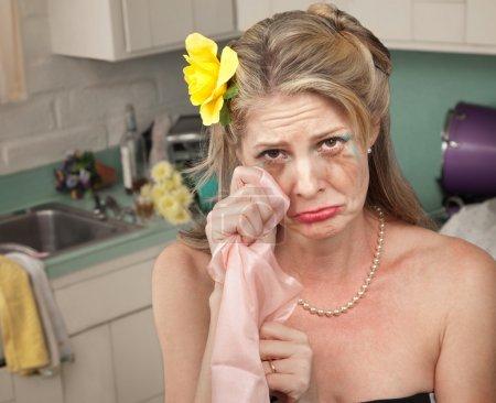Photo for Caucasian housewife wipes tears with napkin in her kitchen - Royalty Free Image