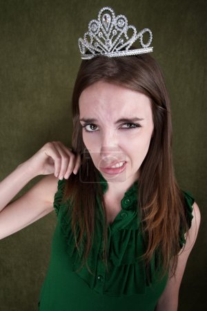 Disgusted Young Woman With A Tiara Crown...