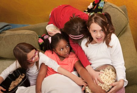Little Girls Grab Popcorn