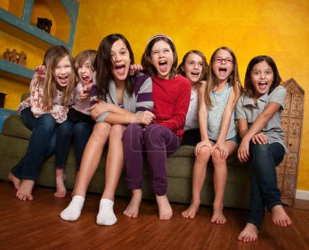 Photo for Group of happy barefoot girlfriends scream out - Royalty Free Image