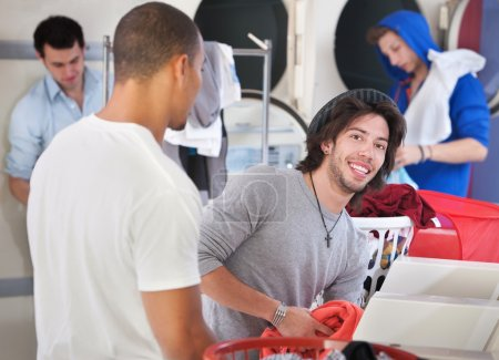 Smiling Man In Laundromat