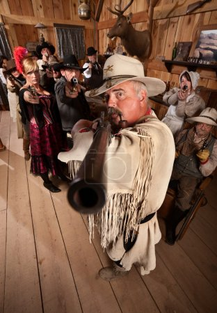 Cowboy Aims Rifle Over Arm