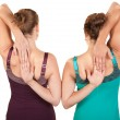 Back view of women stretching their arms over whit...