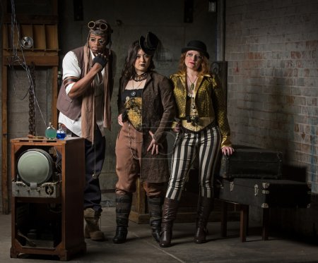 Three Young Diverse Steampunks in Retro Lair...