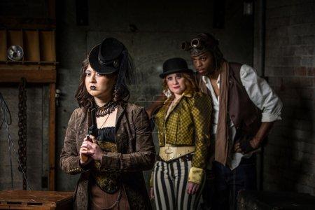 Three Steampunks with in Underground Retro Lab...