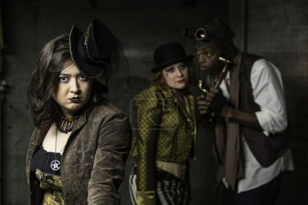 Young Steam Punks PosIng in Underground Lair...