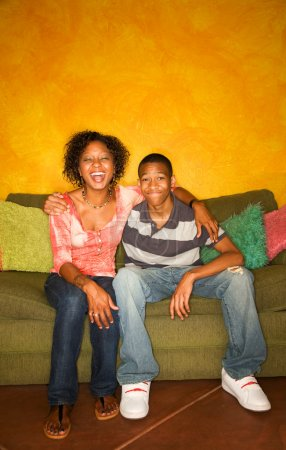 African-American woman and teen  on green sofa