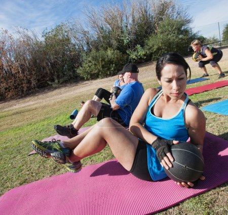 Latino Woman Doing Sit-Ups