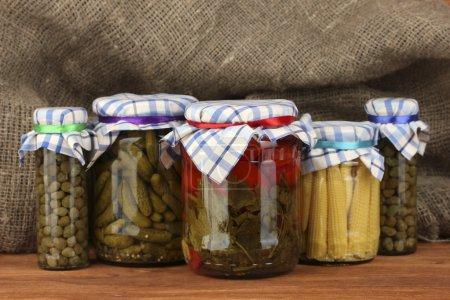 Banks canned vegetables on sack background