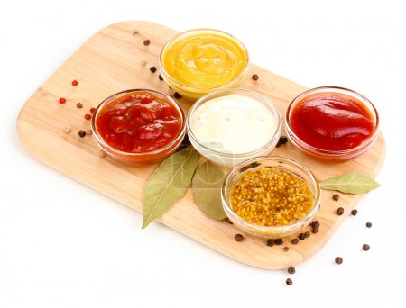 Photo for Various sauces on chopping board isolated on white - Royalty Free Image