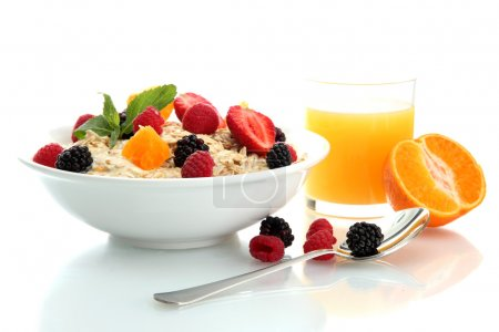 Photo for Tasty oatmeal with berries and glass of juice, isolated on white - Royalty Free Image