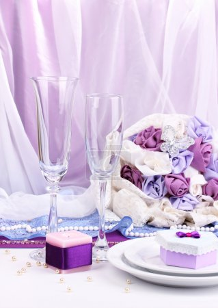 Serving fabulous wedding table in purple color on white fabric background