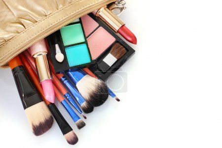 make up bag with cosmetics and brushes isolated on white