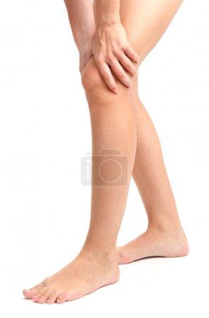 Photo pour Femme tenant la jambe endolorie, isolée sur blanc - image libre de droit