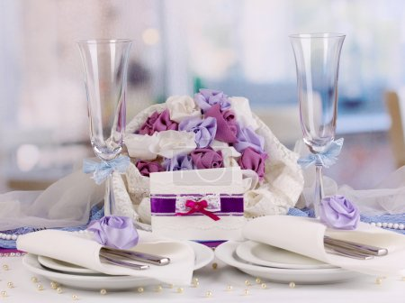 Serving fabulous wedding table in purple color of the restaurant background