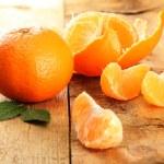 Ripe tasty tangerines on wooden background...