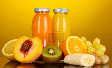 Delicious multifruit juice in a bottle and fruit