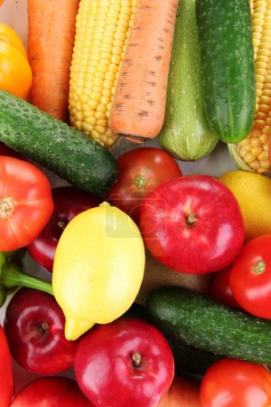 Assortment of fresh vegetables and fruits as a background