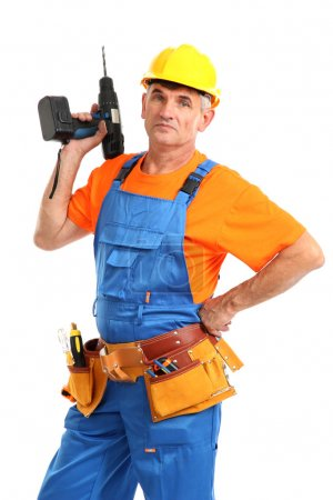Male builder with drill in hand isolated on white close-up