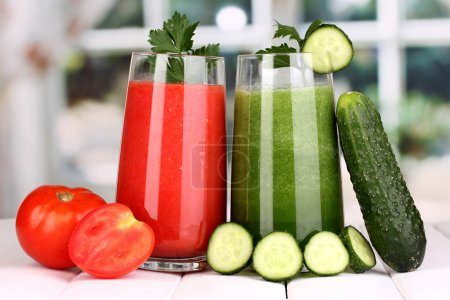 Photo for Fresh vegetable juices on wooden table, on window background - Royalty Free Image