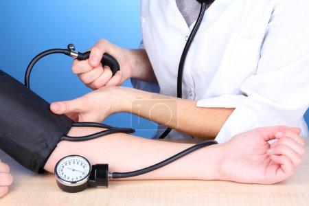 Blood pressure measuring on blue background