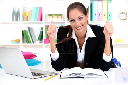 excited young business woman at office