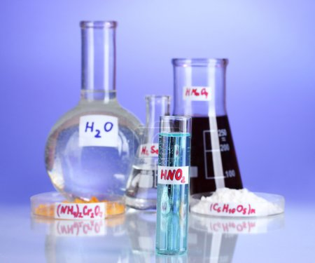 Test-tubes with various acids and chemicals on violet background