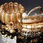 Beautiful golden jewelry on grey background...