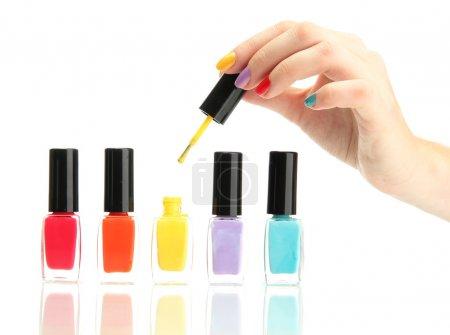 set of nail polishes isolated on white