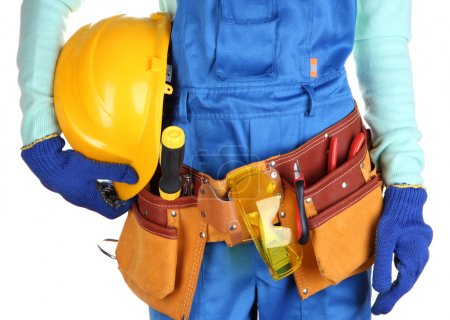 Male builder in blue overalls with yellow helmet isolated on white