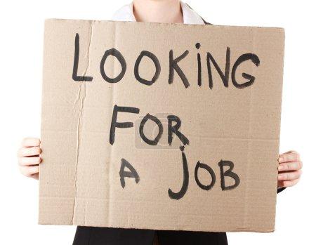 Photo pour Femme d'affaires tenant à la recherche de signe - image libre de droit
