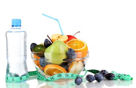 Glass bowl with fruit for diet, measuring tape and water bottle isolated on white