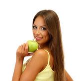 Krásná mladá žena s zelené jablko, izolované na bílém