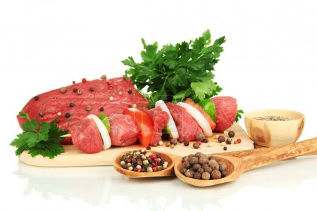 Raw beef meat marinated with herbs and spices isolated on white