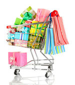 Christmas gifts and shopping in trolley isolated on white