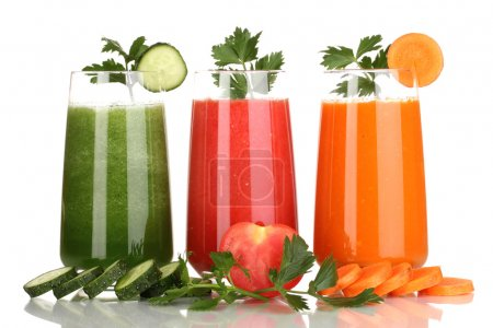 Fresh vegetable juices isolated on white