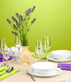 """Постер, картина, фотообои """"Сервировка стола в фиолетовых и зеленых тонов на цвет фона"""""""