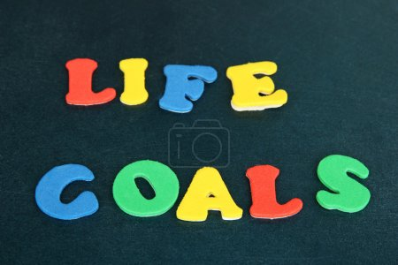 Phrase LIFE GOALS in colorful letters on school board close-up