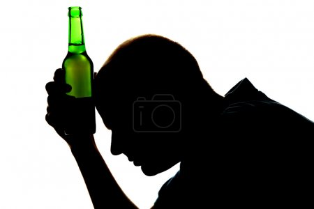 Photo for Silhouette of man with bottle of alcohol, isolated on white - Royalty Free Image