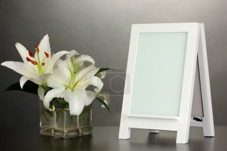 White photo frame for home decoration on grey background