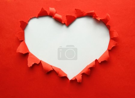 Photo for Beautiful torn paper in heart shape symbol - Royalty Free Image