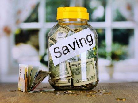 Foto de Money in the bank on room background - Imagen libre de derechos