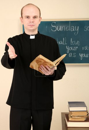 Priest in Sunday school