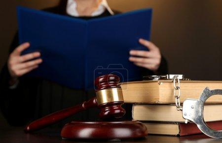 Judge read verdict on brown background