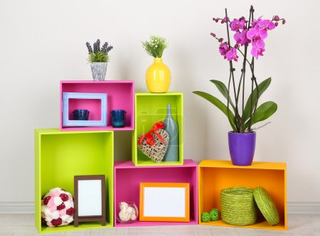 Photo for Beautiful colorful shelves with different home related objects - Royalty Free Image