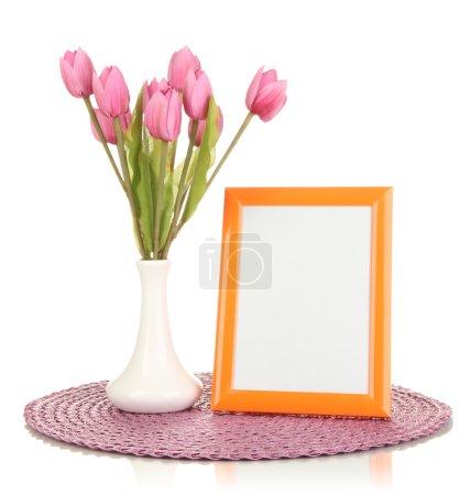 Photo pour Cadre photo coloré et fleurs isolés sur blanc - image libre de droit