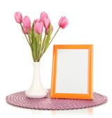Colorful photo frame and flowers isolated on white