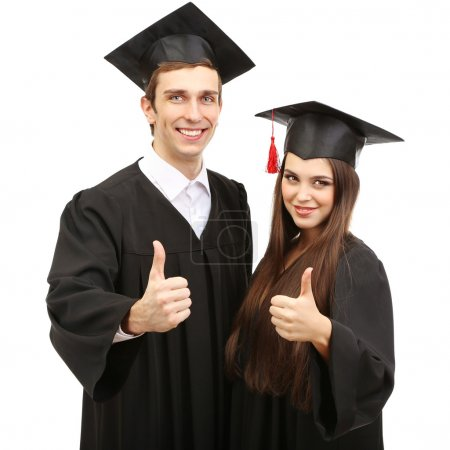Photo for Two happy graduating students isolated on white - Royalty Free Image