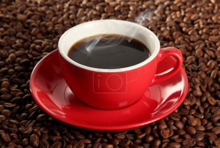 Photo for Cup of coffee on coffee beans background - Royalty Free Image